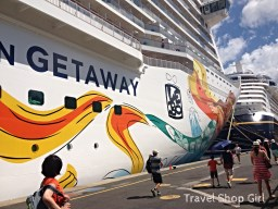 Norwegian Getaway docked behind Disney Fantasy