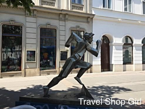Modern running man street sculpture