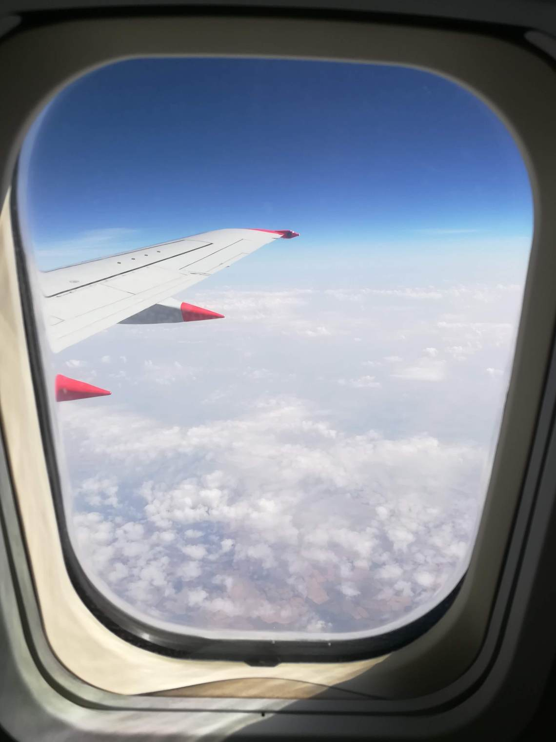 A photo taken through the window of an airplane on a stress-free journey