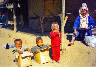 Children play in the street around the houses