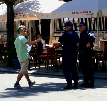 Protester in Sofia hands out water to policemen
