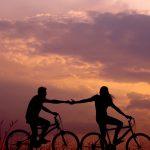 TravelSisters_couple_romance_solo_travel_bicylce_sunset