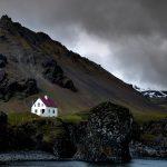solo travel destination_iceland_house_mountain