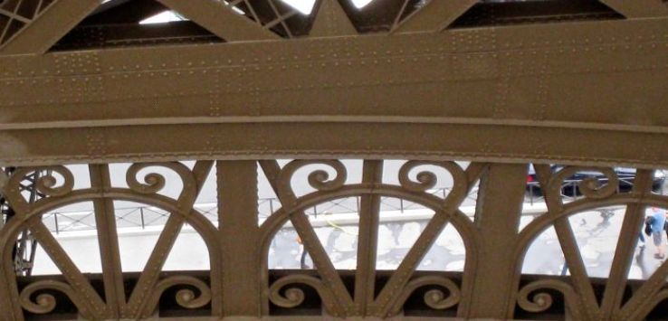Closeup of lacy ironwork of Eiffel Tower
