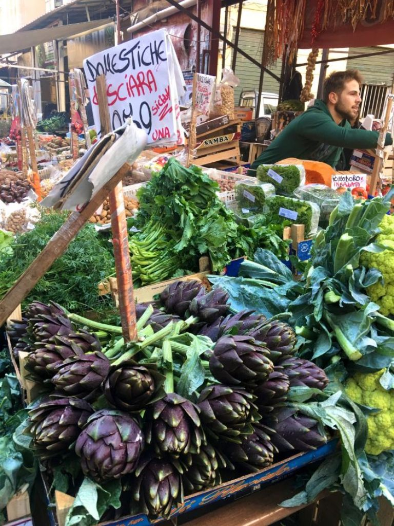 Off-season travel in Palermo, Italy: No coat needed to explore the city's markets in late November. (Photo by Suzanne Ball. All rights reserved.)