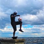 Street performers-Paris-Soccer ball on knee