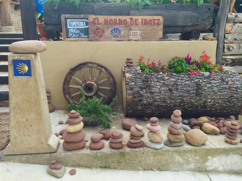 """Camino de Santiago: How I Started""...Bars and cairns (stacks of stones) welcome pilgrims all across the Camino de Santiago. Both are meaningful....(Photo by Suzanne Ball. All rights reserved.)"