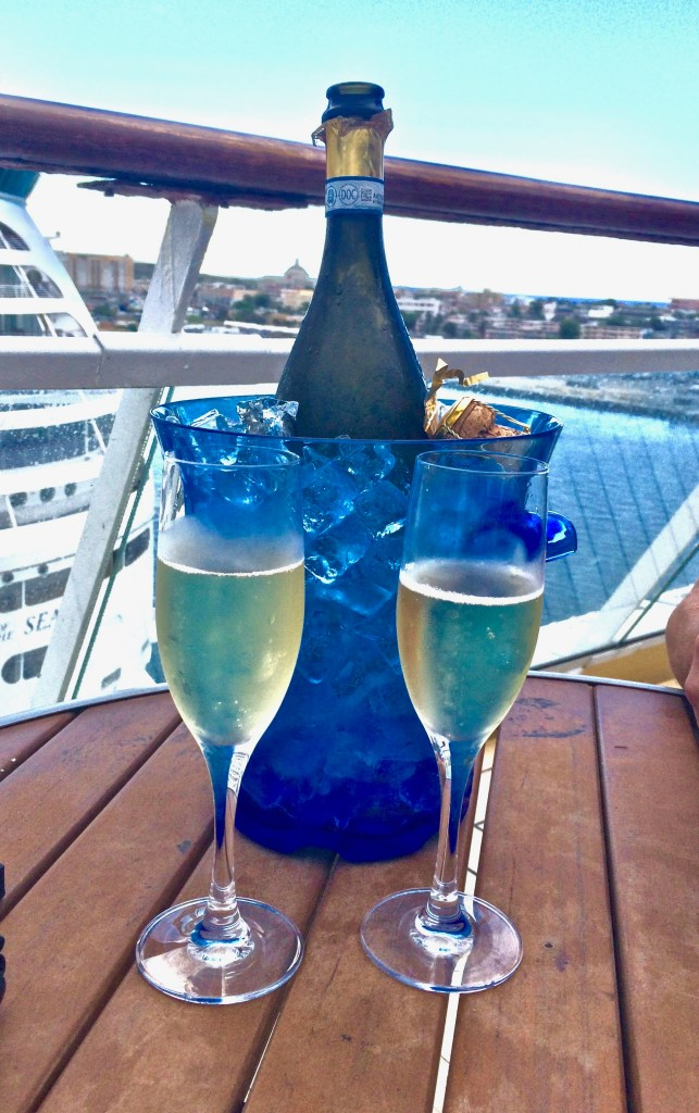 Disadvantages of cruises: Go ahead, enjoy that bottle of champagne...besides being overpriced, it comes with an 18 percent gratuity.
