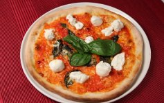 Naples pizza is simple: crust, fresh tomatoes, mozzarella, and olive oil. And a few basil leaves!