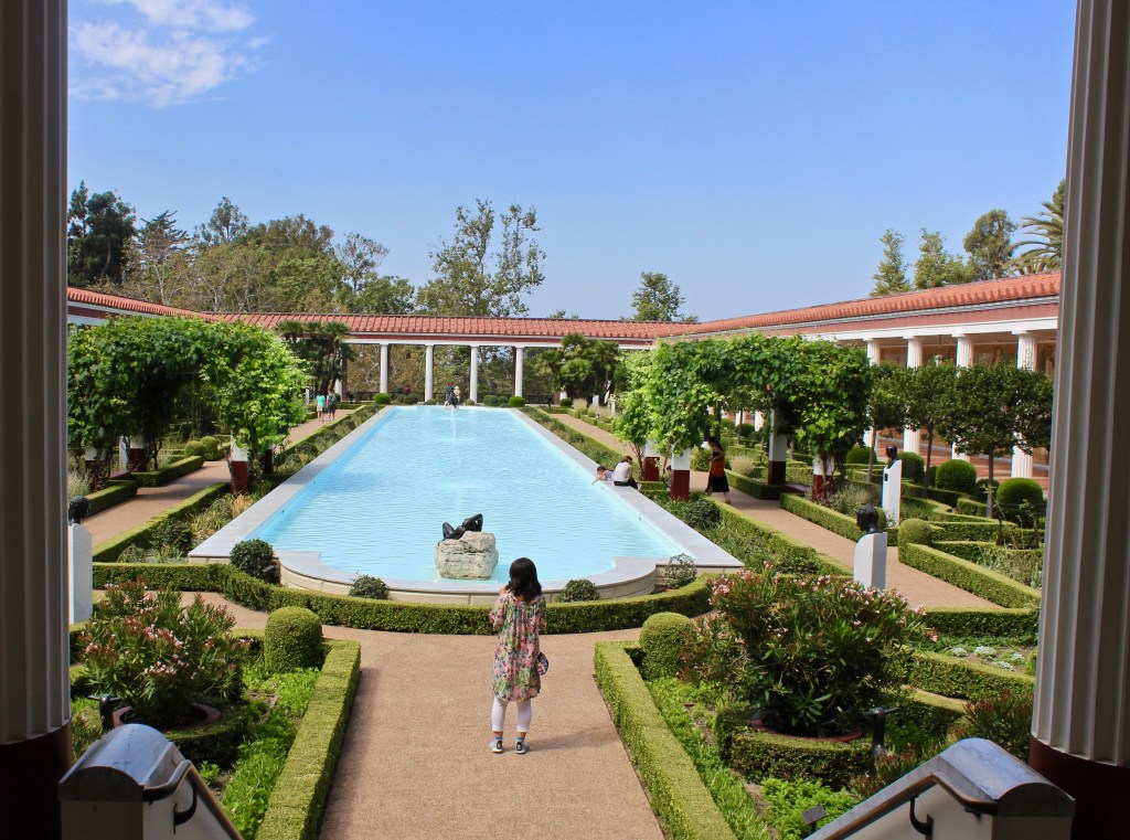 The Outer Peristyle of the Getty Villa shows how the space was used as a place of beauty, as well as a garden for the household. Fish were kept in the long pond. (Photo by Suzanne Ball. All rights reserved.)
