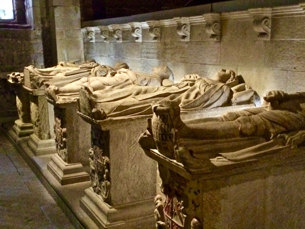 "Along with Roman roads, you get to see lots of dead royalty. Many of the large cathedrals have rows and rows of tombs with effigies. Notice the ""foot rest"" so their toes don't hang over the edge..."