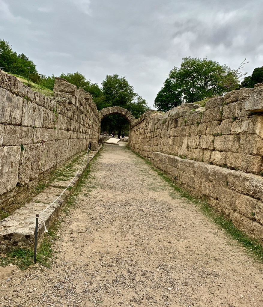 The passage to the stadium was once covered entirely by a stone arch roof. Today, only one section remains. It's easy to imagine how athletes felt as they ran down the narrow entry into the stadium