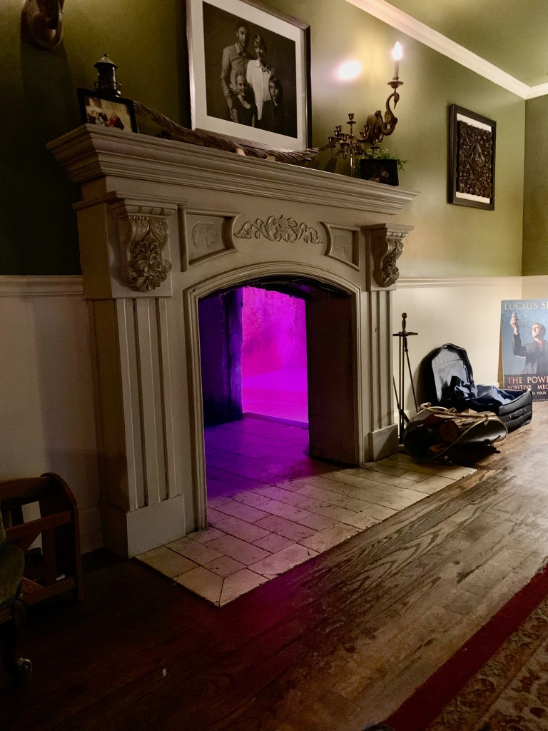 Feel brave? Climb into the fireplace and find out where that pink light is. (Photo by Suzanne Ball)