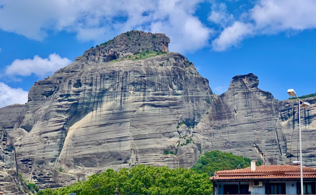Meteora rock formations suddenly appear as you approach Kalambaka.