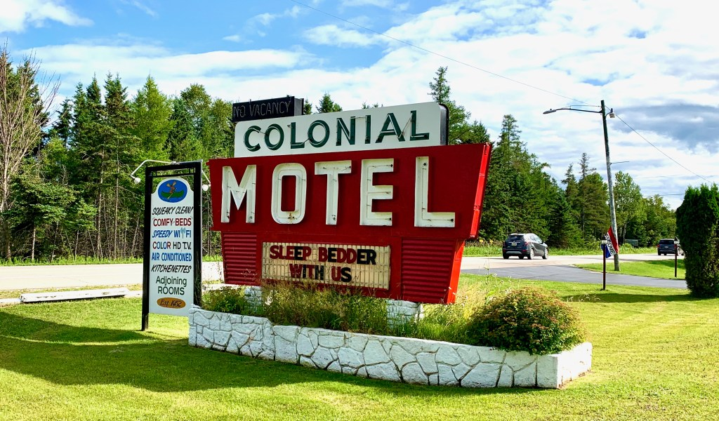 Colonial Motel sign--Your solo road trip to Manistique, MI should include a stay at a classic motel!