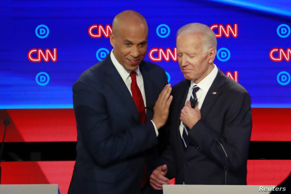 U.S. Senator Cory Booker and former Vice President Joe Biden talk during a commercial break on the second night of the second U.S. 2020 presidential Democratic candidates debate in Detroit, Michigan, U.S.