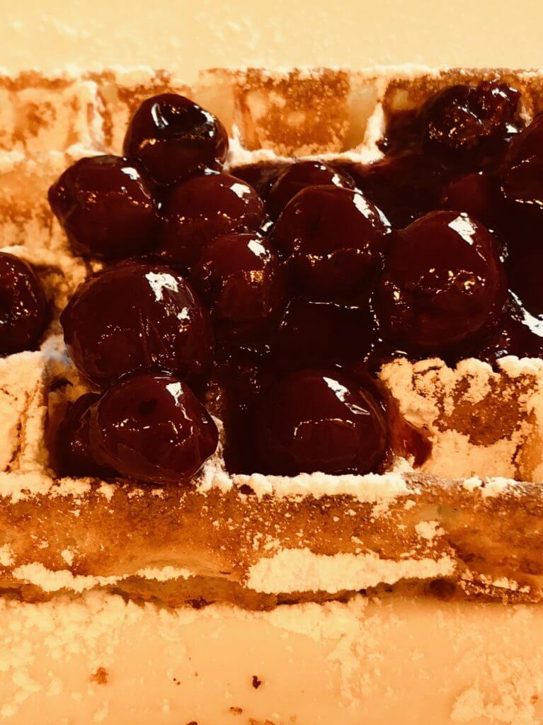 Warm cherries atop a light, crispy waffle