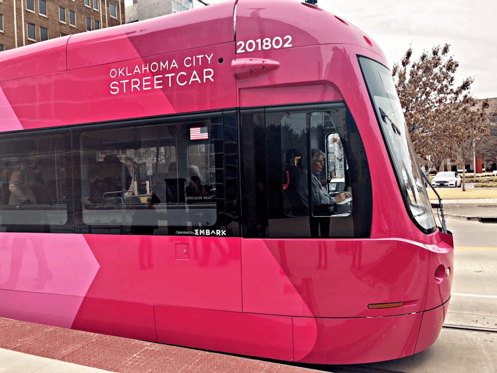 Magenta and pink Redbud Streetcar in OKC. Exploring OKC neighborhoods