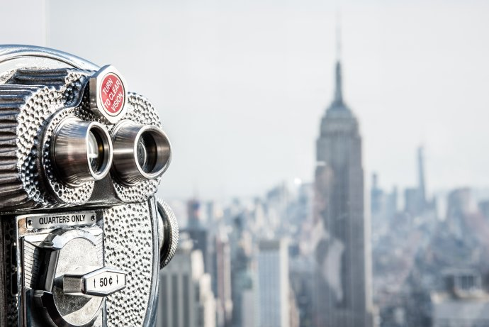 Top of the Rock view of Empire State building with binoculars.