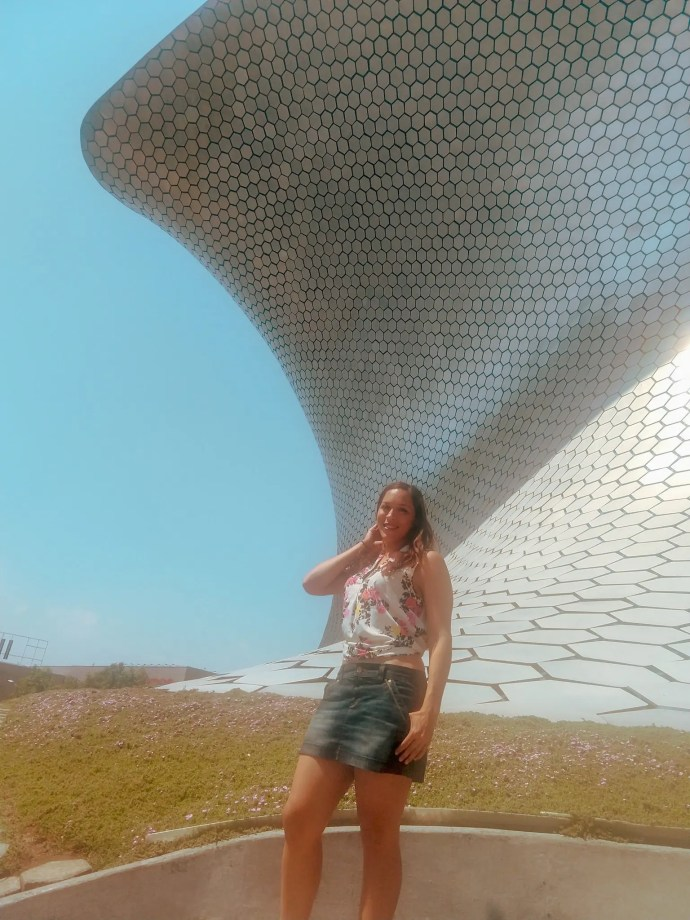 Sarah Fay travel blogger standing in front of Carlos Slim's private collection housed in the modern Soumaya Museum in Polanco Mexico City