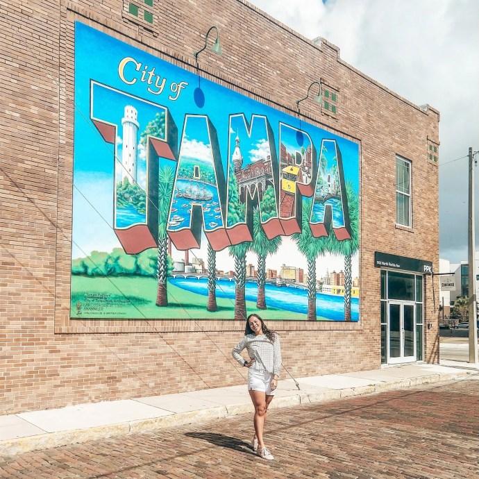 Sarah Fay in front of Tampa Postcard Mural