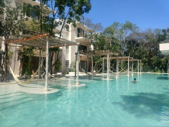 Holistika Pool and hotel in tulum Mexico surrounded by the Tulum national park in Mexico