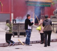 """Worshipers outside the """"First Hall"""" of the Lama Temple"""