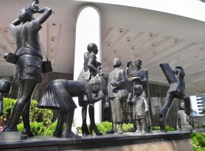 China, Hong Kong, Conrad Hilton, people, statues, entrance, bronze