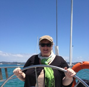 At the helm of The Phantom in the Bay of Islands, New Zealand