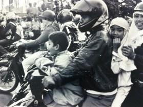 Family on a motorbike in Jakarta, Java.