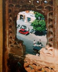 View through a window of Hawa Mahal down to a street in Jaipur, India