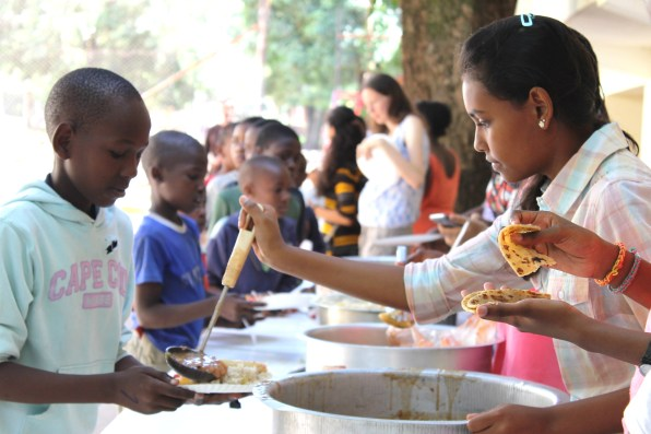 Students sharing food at Isamilo International School's Saturday School Christmas Party.