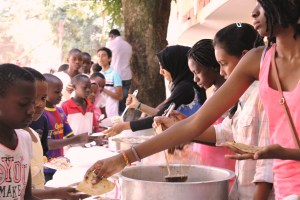 Serving up food at the Christmas Saturday School in Mwanza, Tanzania.