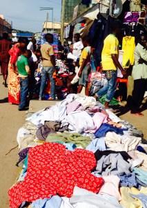 Clothes shopping on Rwagasore Road near the Central Market in Mwanza, Tanzania.