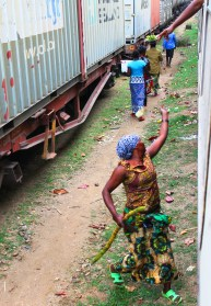 A sugar cane vendor catching her money from the window - On the train from Mwanza to Dar Es Salaam, Tanzania.