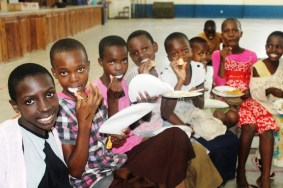 Enjoying food at Isamilo's Saturday School Christmas party.