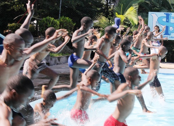 Saturday School students jumping into the pool together at the last session of the year at Isamilo International School in Mwanza, Tanzania.