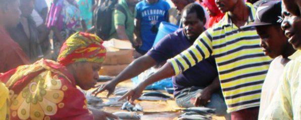 Early morning bargains at the Kivukoni Fish Market in Dar Es Salaam, Tanzania cropped