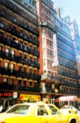 Chelsea hotel and yellow cab in New York, USA