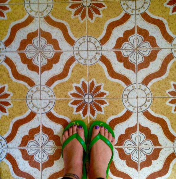 Feet selfie on tiled bathroom floor in Nairobi, Kenya
