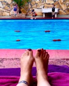 Resting by the pool while the kids play at the Colloseum Hotel in Dar es Salaam, Tanzania