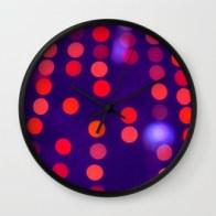 Blurred Indigo and Orange Lights - wall clock