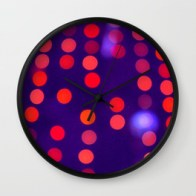 Blurred Indigo and Orange Lights - wall clock for Society6