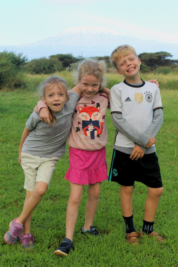 Lottie, Frida and Leon with Mount Kilimanjaro in the background