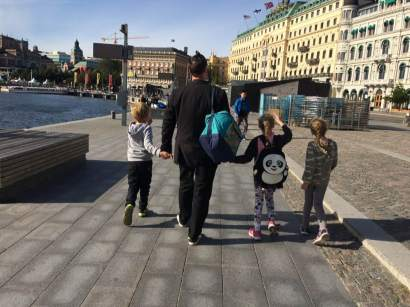 Mark walking with the children on Södra Blesieholmshamnen in Stockholm