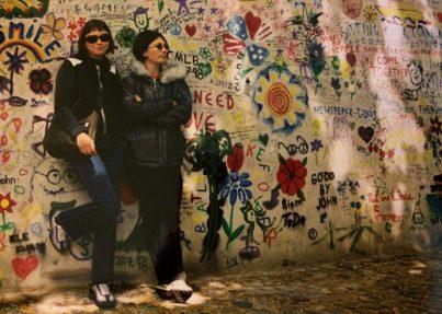 Nats and Tash by the John Lennon Wall in Prague, Czech Republic