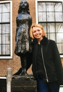 Carol Ann Lee with the Anne Frank statue in Amsterdam