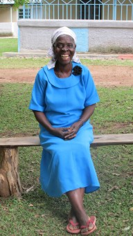 Mama smiling in her blue church prayer group uniform.