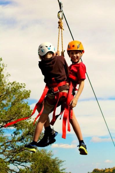Kids zip-lining over Las Terrazas in Cuba