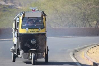 Indian motorized rickshaw on the road